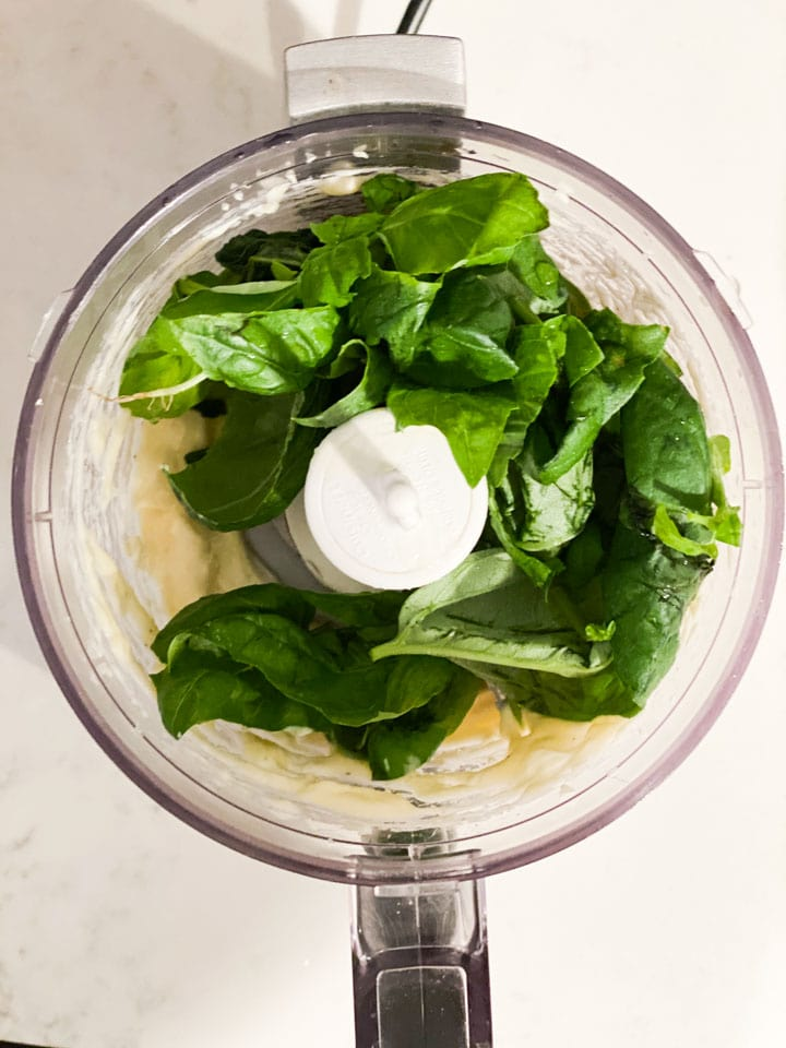 Basil, garlic, and mayonnaise in a food processor