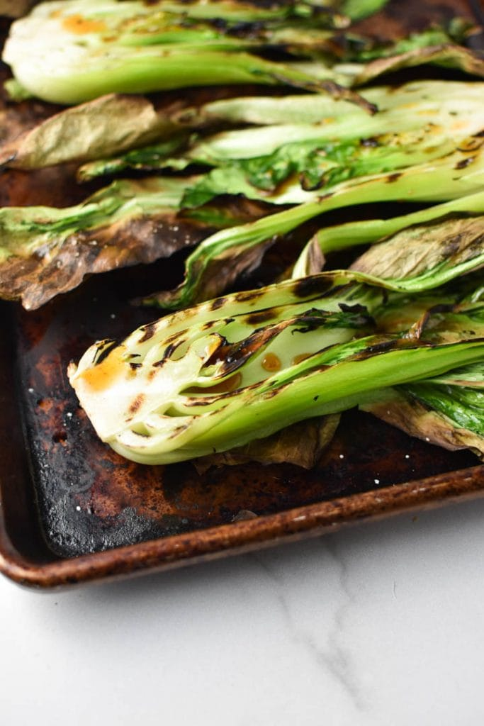 Grilled bok choy with chili oil sprinkled on top