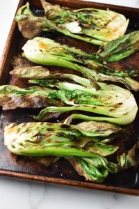 Grilled bok choy on a sheet pan