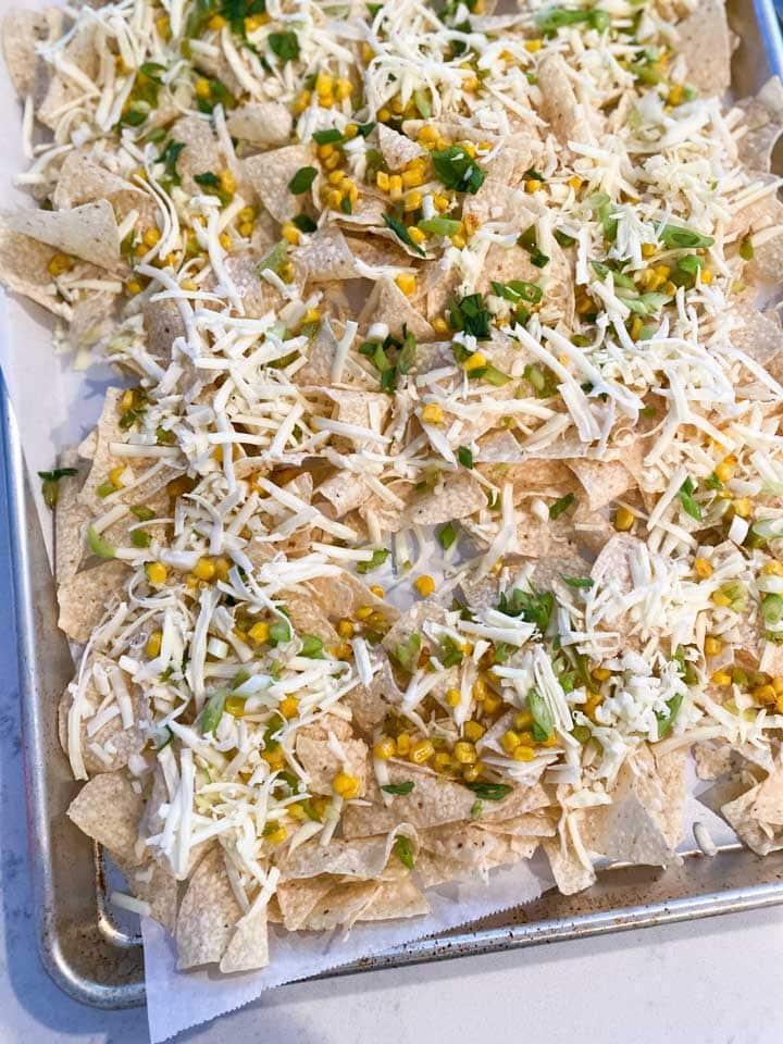 Unbaked sheet pan of nachos