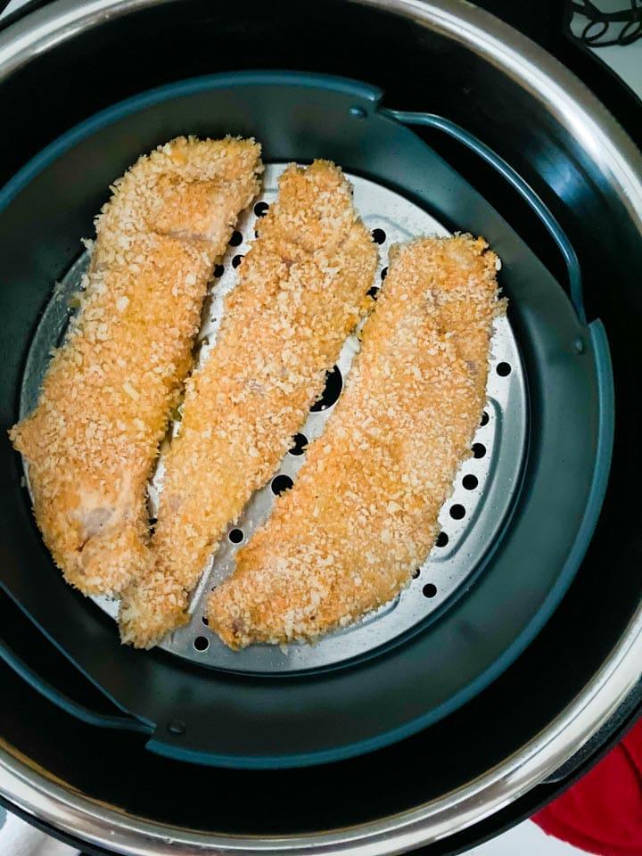 Chicken tenders in an instant pot air fryer basket