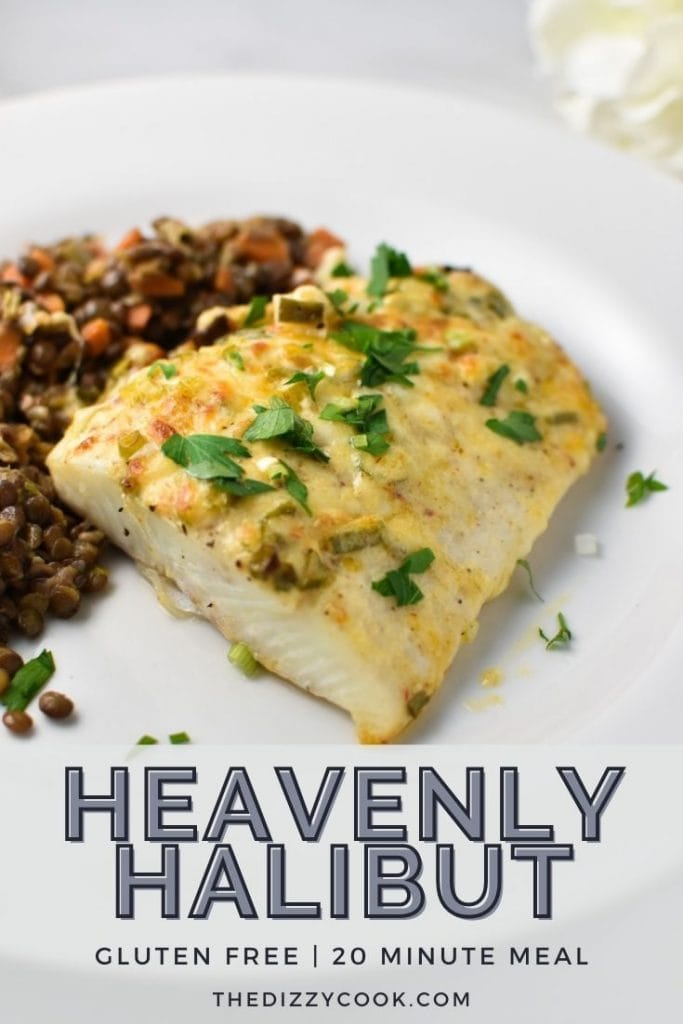 Baked halibut with mayonnaise on a white plate topped with parsley