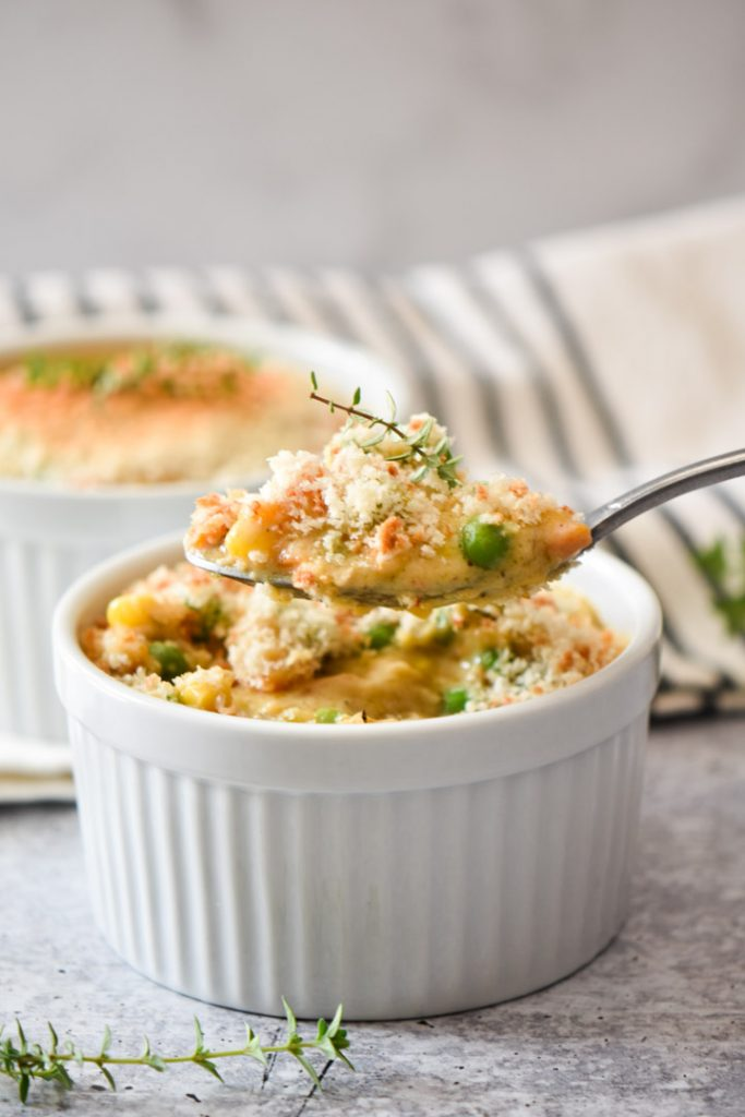 A spoon with lots of crustless chicken pot pie filling on it