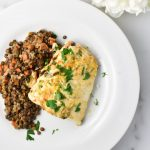 Heavenly halibut on a white plate with lentils