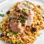 Air fryer pork tenderloin sliced and served on wild rice pilaf