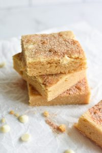 Stacked snickerdoodle blondies with cinnamon sugar on top