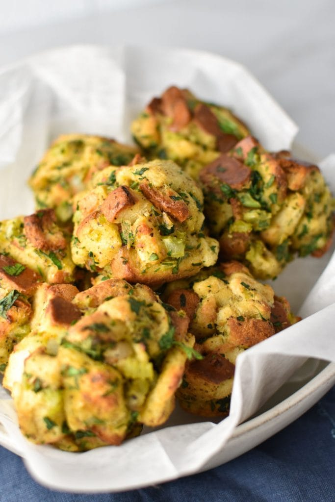 Stuffing balls in a bowl with parchment paper