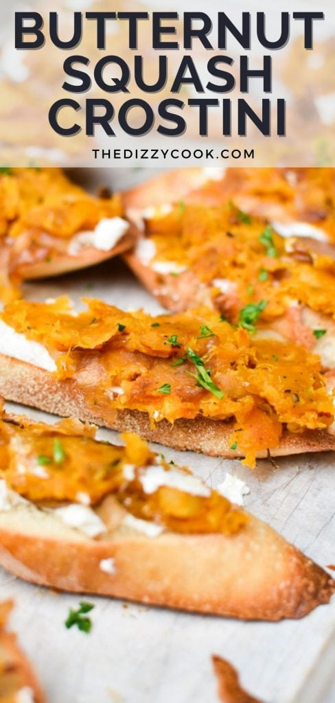 Butternut squash crostini lined up on a sheet pan and sprinkled with mint