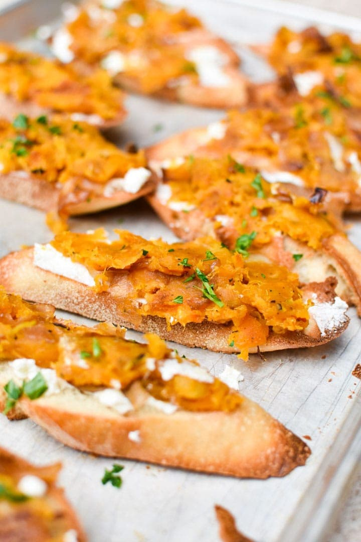 Crostini topped with butternut squash mash and ricotta cheese