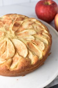 Layered apples on top of a french apple cake