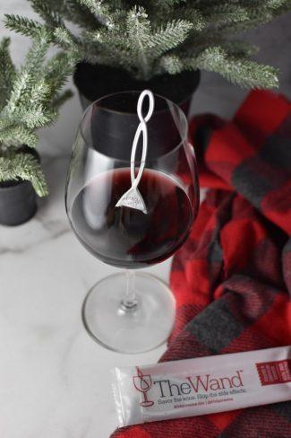 A glass of wine with a purewine wine wand