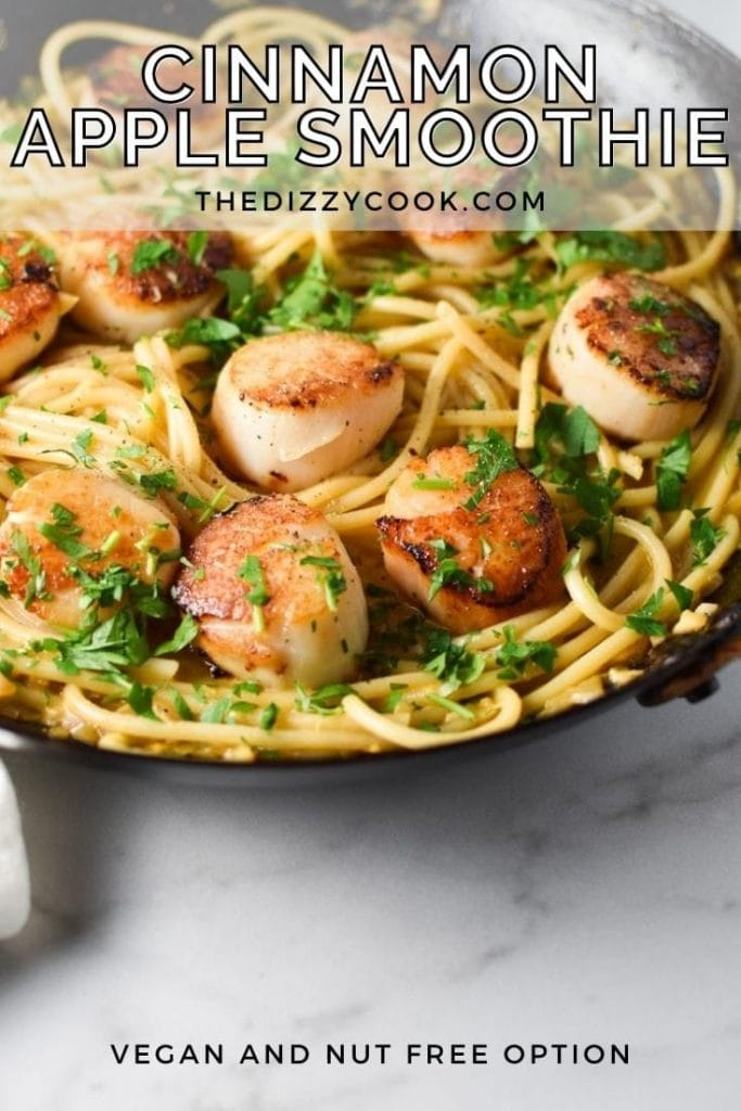 Seared scallops on top of creamy garlic pasta sprinkled with parsley