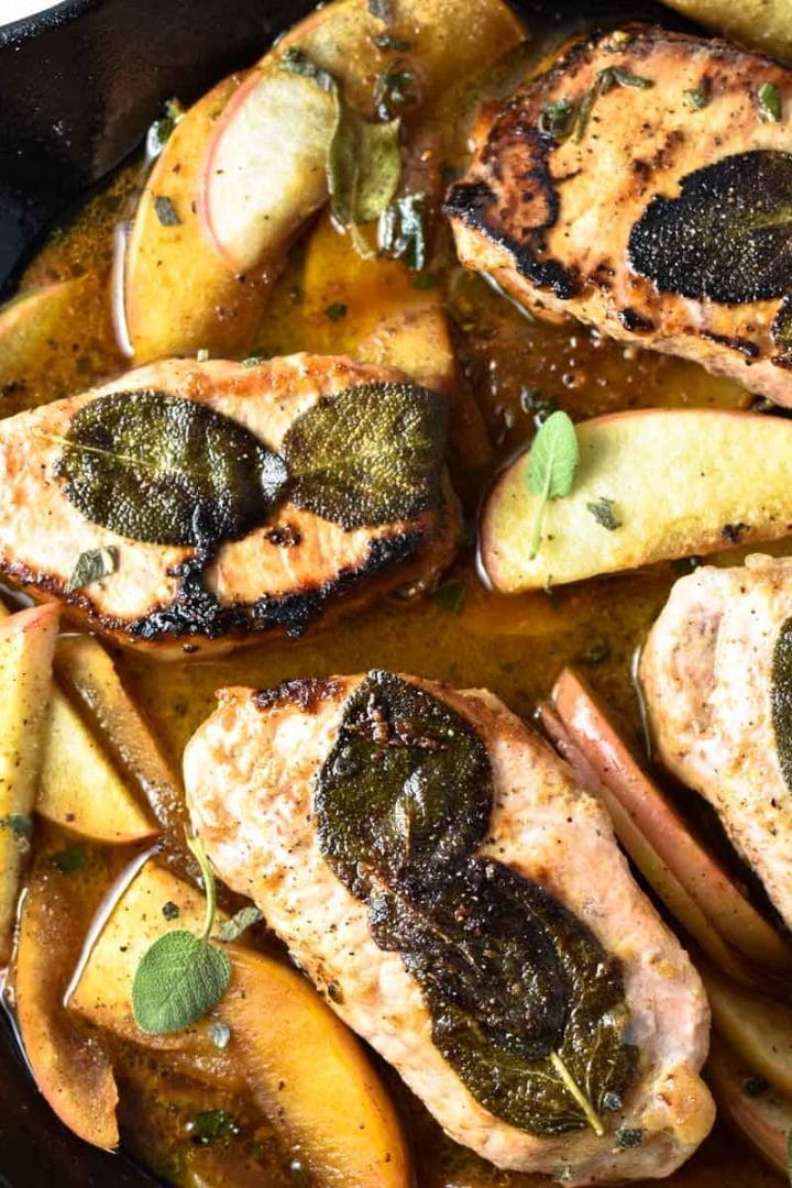 Apple cider pork chops in a cast iron pan