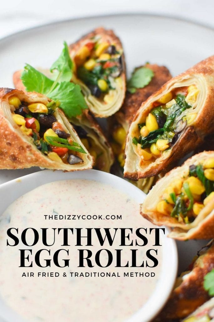 Southwestern egg rolls surrounding a bowl of spicy ranch dipping sauce