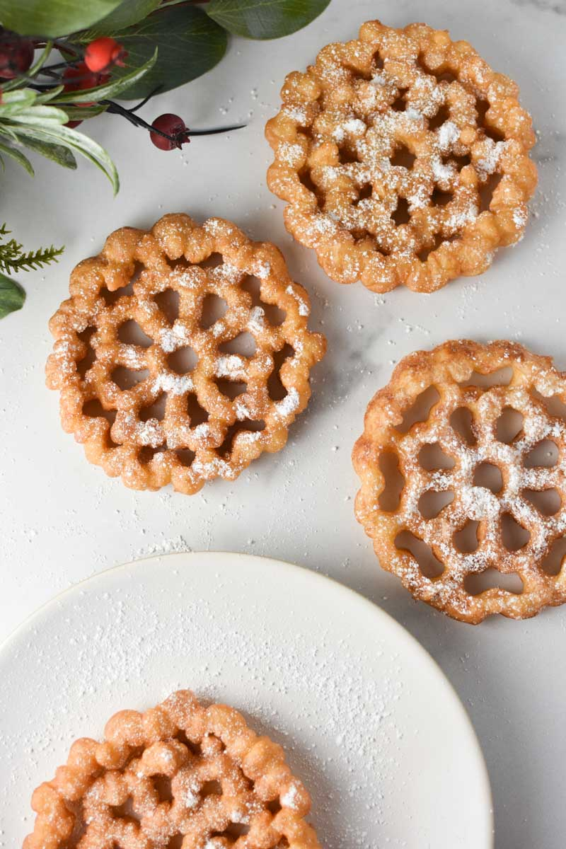 Rosette cookies on a plate and table
