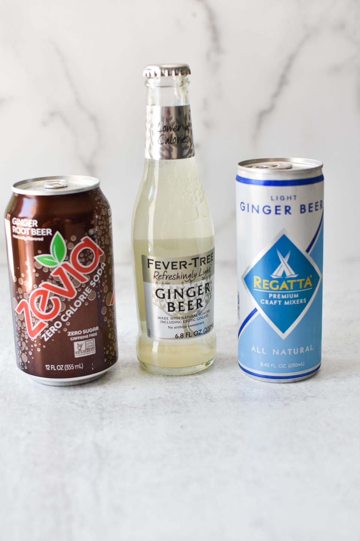 A bunch of ginger beers on a marble table