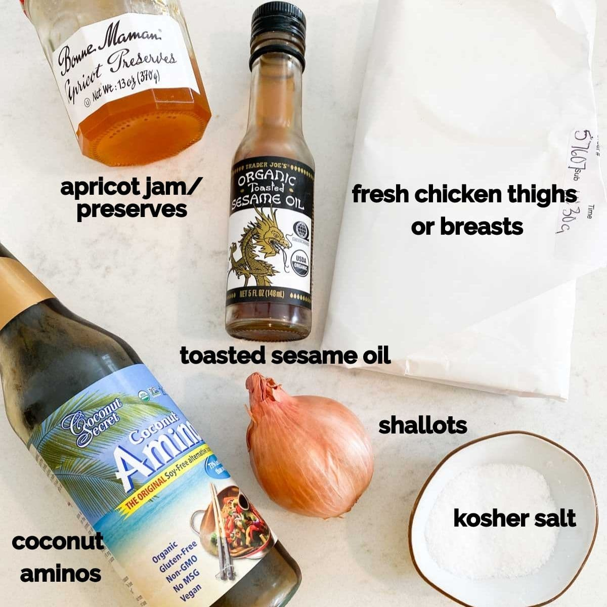 The ingredients needed for this recipe all laid out on a white marble table.