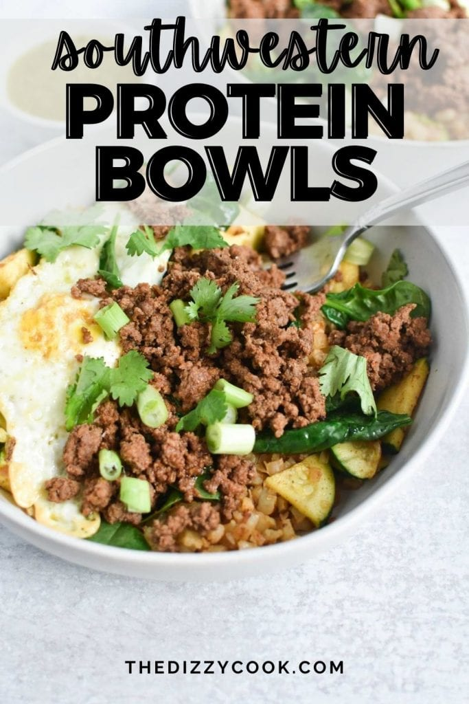 Ground beef, eggs, and green onion in a white bowl with a fork