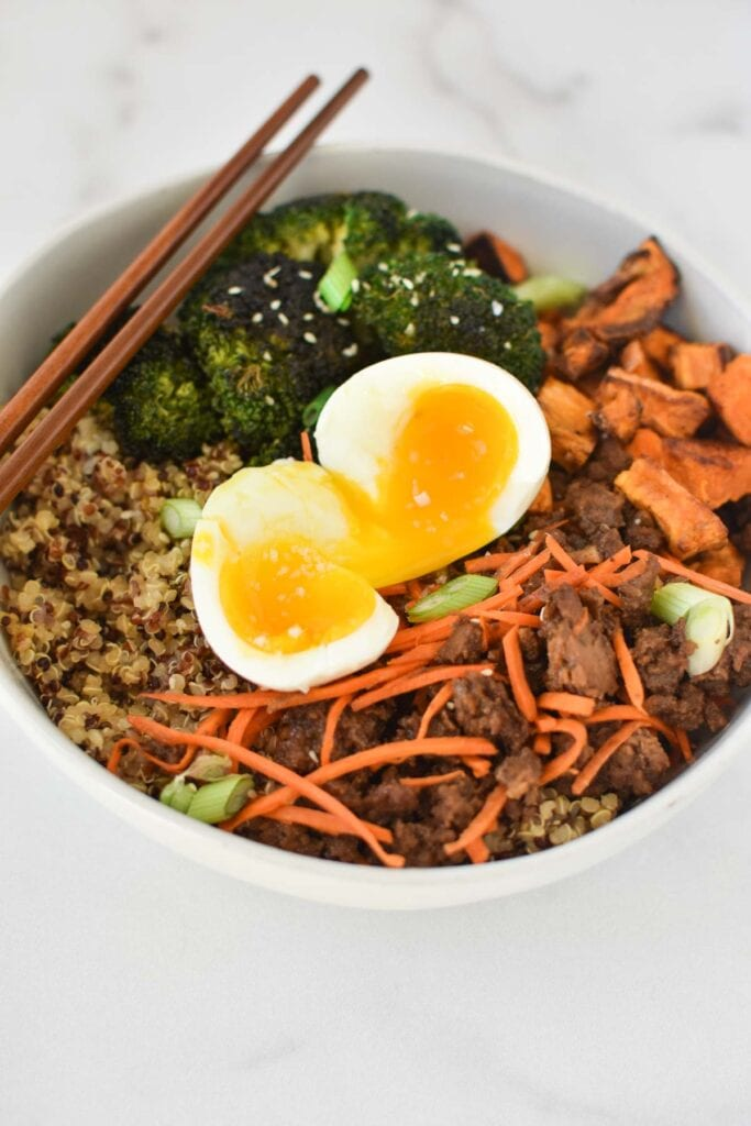 Ground beef, broccoli, carrots, and quinoa topped with a jammy egg